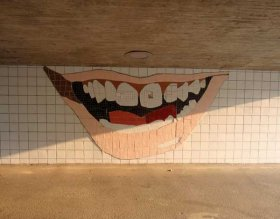 <p>... and a tiled representation of his smile in the tunnel underneath.</p>